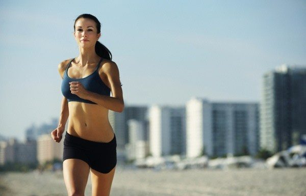Young Woman Running Jogging on South Beach Miami